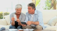 Stock Video Footage of Elderly couple calculating their bills