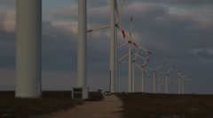 Chrysler 300 C tarmac road power windmills sunset clouds dark sky424 Stock Footage