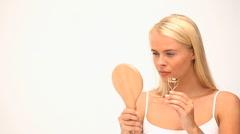 Blond woman plucking her eyelashs Stock Footage