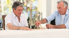Senior friends men playing chess - stock footage