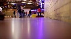 Camera on floor of Roller Skating Rink Stock Footage