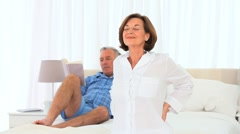 Senior man giving his wife a massage Stock Footage