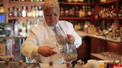 Female cocktail waiter in a classic looking cocktail Stock Footage