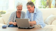 Stock Video Footage of Senior couple looking at a computer