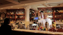 Female cocktail waiter in a classic looking cocktail bar bartender Stock Footage