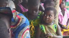 Africa: Village children sitting in crowd Stock Footage