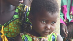 Africa: Beautiful little girl on sister's lap - stock footage