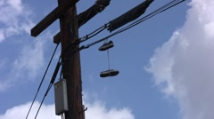 Shoes Hanging On Wire medium Stock Footage