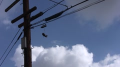 Shoes Hanging On Wire wide Stock Footage