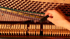 Stock Video Footage of Piano being tuned closeup