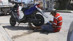 Mexican boy fixing a tire - stock footage