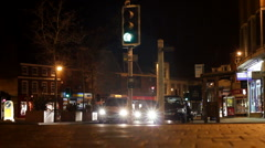 The lights of road traffic in a town centre at night. Leicestershire England Stock Footage