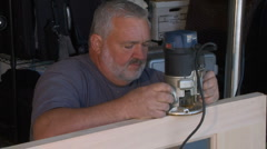 Carpenter using Router on door Stock Footage
