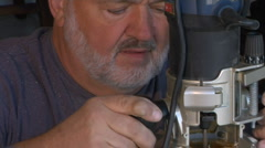 Pan to Router from Carpenter Handyman Stock Footage