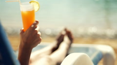 Beautiful young woman drinking cocktail, closeup  Stock Footage