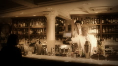 Cocktail waiter in a classic looking cocktail bar bartender Stock Footage