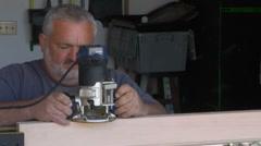 Handyman Carpenter using Router sawdusts flies Stock Footage