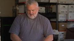 Handyman carpenter working in garage Stock Footage