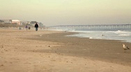 Stock Video Footage of Beach Walkers