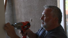 Carpenter drilling hole Stock Footage