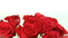 rotating bouquet of red roses in glass bowl - stock footage
