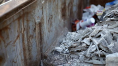 Concrete and rubble in a dumpster Stock Footage