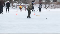 Kids playing  ice hockey on the frozen pond Stock Footage