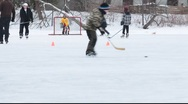 Stock Video Footage of kids playing  ice hockey on the frozen pond