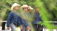 Stock Video Footage of Urban Cowboys Entering Barn