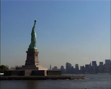 Statue of Liberty sideview with NY Skyline, New York GFSD Stock Footage