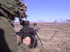 Military, soldier and automatic weapon close and personal Stock Footage