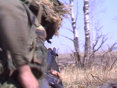 Military, soldier changing mag with rifle and fire Stock Footage
