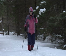 Mature woman XC skiing Stock Footage