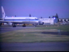 aircraft, 1987 archival, DC8 airplane taxi turn, Calgary - stock footage