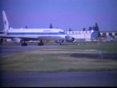 Stock Video Footage of aircraft, 1987 archival, DC8 airplane taxi turn