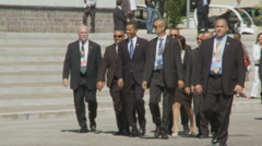 President Obama long walk to the G8 summit building - stock footage