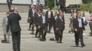 President Obama long walk to the G8 summit building Stock Footage