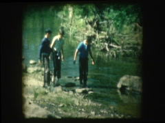 Young boys explore creek bed Stock Footage