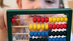 Little girl count on abacus - stock footage