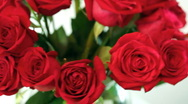 Stock Video Footage of rotating bouquet of red roses in glass vase