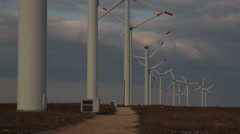 Stock Video Footage of tarmac road power windmills sunset clouds dark sky2465