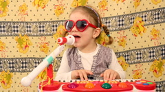 little girl play music - stock footage
