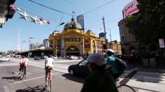 Melbourne Flinders Station Crossing with Tram and Bicycles Stock Footage