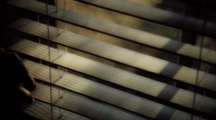 Looking through window blinds Stock Footage