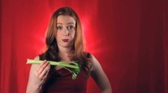 Questioning her snack of vegetables Stock Footage