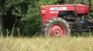 Tractor passes close and long shot Stock Footage