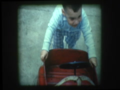 Little boy with antique toy truck Stock Footage