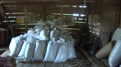 filled bags of grain in barn - stock footage