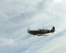 Supermarine Spitfire Mk IIA (Royal Air Force code P7350). Air to Air over UK Stock Footage