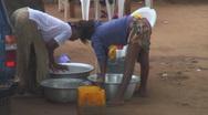 Africa: urban women scrubbing clothes Stock Footage